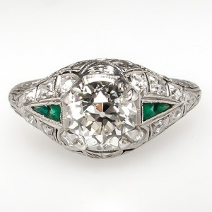 this deco engagement ring features green glass accents