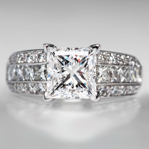 Capture the Essence! of Alicia Keys' Engagement Ring with this wide band channel-set diamond engagement ring featuring a 2.26-carat Princess Cut Diamond. Photo ©2014 EraGem Jewelry.