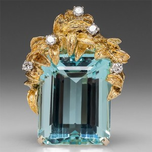 Capture the Essence! of Aquamarine's amuletic powers with this stunning 36-carat Aquamarine Pendant mounted in yellow gold and white diamonds. Photo ©2015 EraGem Jewelry.