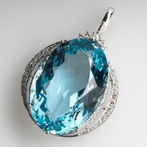 Capture the Essence! of March's birthstone with this magnificent 66-carat, oval-cut aquamarine pendant in white gold and white diamonds. Photo ©2015 EraGem Jewelry.