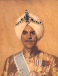 The Maharajah Jagatjit Singh of Kapurthala wears the Cartier Turban Ornament fashioned in 1926. The largest hexagonal emerald weighs 117.40 carats.