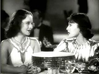Paulette Goddard (left) sits with Louise Rainer on set for the film 'Dramatic School' (1938). Ms. Goddard appears to be wearing her diamond fringe necklace in the shoot. Photo in public domain.