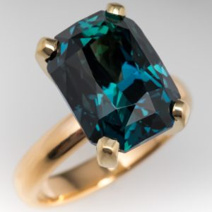 peacock blue green sapphire engagement ring